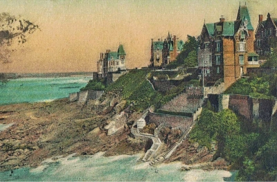Illustration (maisons sur des rochers au bord de l'eau)